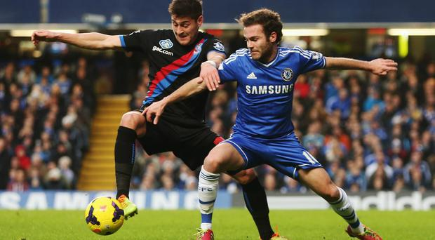 Juan Mata, formerly of Chelsea, tussling with Joel Ward of Crystal Palace