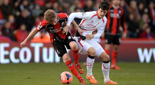 Liverpool's Luis Alberto (right) and AFC Bournemouth's Eunan O'Kane battle for the ball during the FA Cup, Fourth Round match at Goldsands Stadium, Bournemouth. PRESS ASSOCIATION Photo. Picture date: Saturday January 25, 2014. See PA story SOCCER Bournemouth. Photo credit should read: Andrew Matthews/PA Wire. RESTRICTIONS: Editorial use only. Maximum 45 images during a match. No video emulation or promotion as 'live'. No use in games, competitions, merchandise, betting or single club/player services. No use with unofficial audio, video, data, fixtures or club/league logos.
