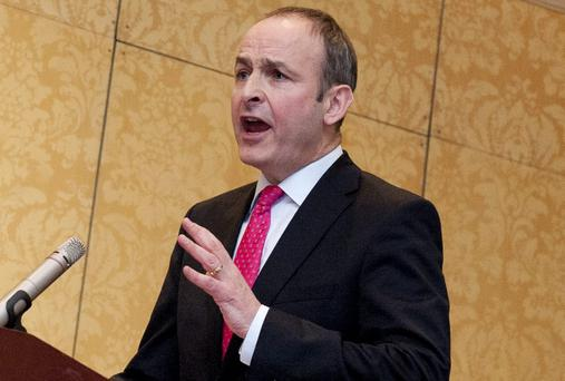 A woman who claims she was sexually abused by a serving garda, before the incident was covered up, has requested an urgent meeting with Fianna Fail leader Micheal Martin (pictured)