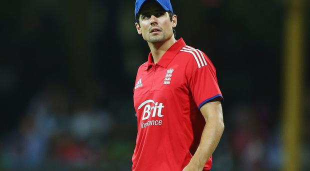 English captain Alastair Cook glances nervously at the scoreboard during game three of the One Day International Series between Australia and England