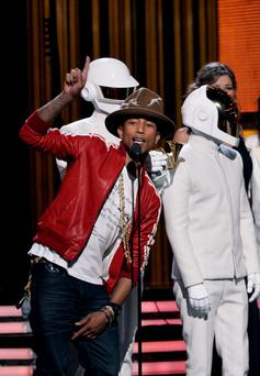 LOS ANGELES, CA - JANUARY 26: Musicians Pharrell Williams, Thomas Bangalter and Guy-Manuel De Homem-Christo of Daft Punk onstage during the 56th GRAMMY Awards at Staples Center on January 26, 2014 in Los Angeles, California. (Photo by Kevin Winter/WireImage)
