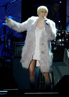 Miley Cyrus performs at the Clive Davis Pre-Grammy Gala and Salute to Industry Icons, honoring Universal Music Group Chairman and CEO Lucian Grainge, in Beverly Hills, California January 25, 2014. REUTERS/Phil McCarten