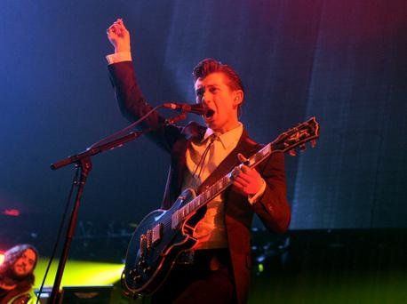 LOS ANGELES, CA - DECEMBER 07: Musician Alex Turner of Arctic Monkeys performs onstage during The 24th Annual KROQ Almost Acoustic Christmas at The Shrine Auditorium on December 7, 2013 in Los Angeles, California. (Photo by Kevin Winter/Getty Images for Radio.com)