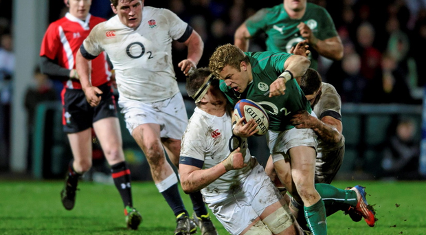 Ian Madigan, Ireland Wolfhounds, is tackled by Jamie George