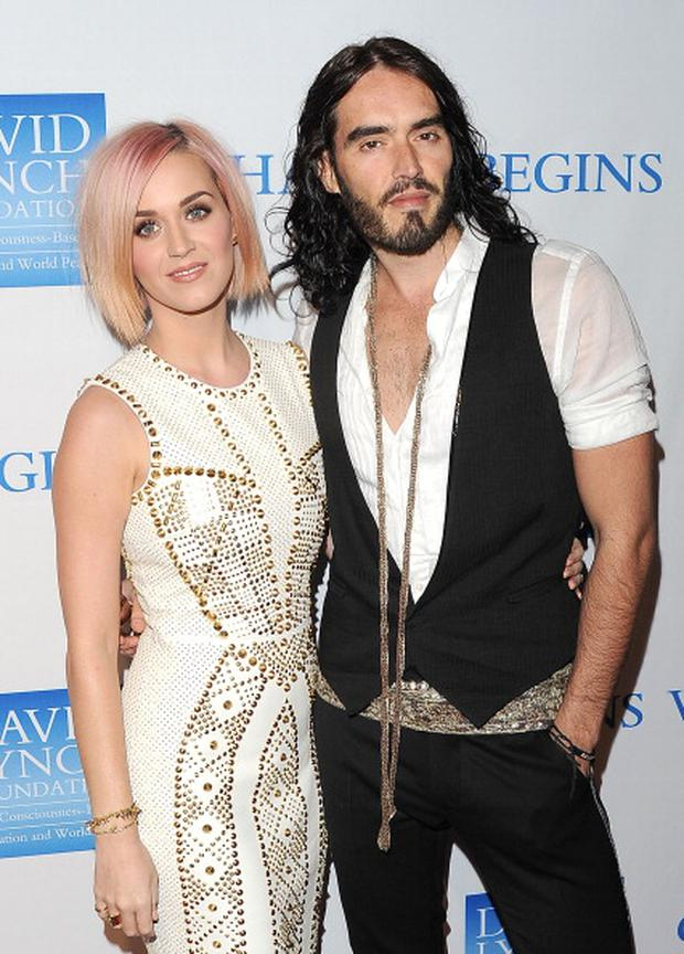 Singer Katy Perry (L) and actor Russell Brand attend the 3rd Annual