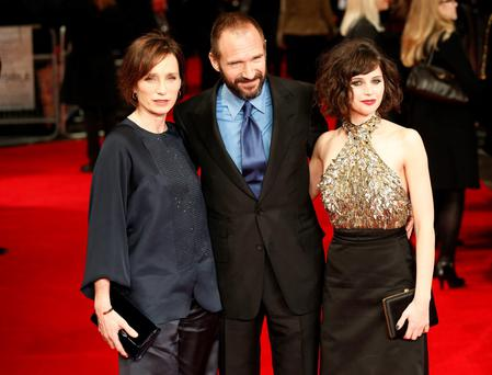 (left to right) Kristin Scott Thomas, Ralph Fiennes, and Felicity Jones arrive at the premiere of 'The Invisible Woman' held at the Kensington Odeon, London
