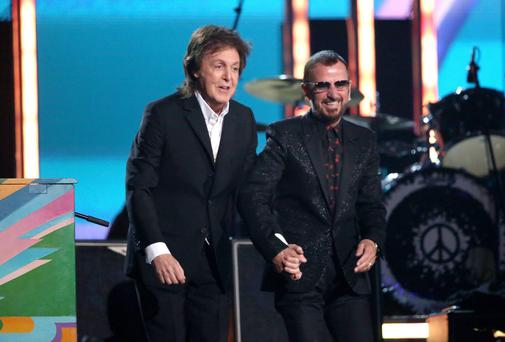 Paul McCartney and Ringo Starr perform on stage at the 56th annual Grammy Awards
