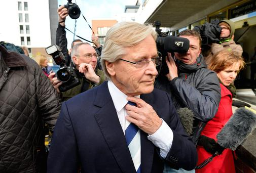 British television actor William Roache walks past reporters as he arrives at the Magistrates Court