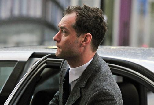 British actor Jude Law arrives to give evidence at the phone-hacking trial at the Old Bailey court in London, on January 27, 2014