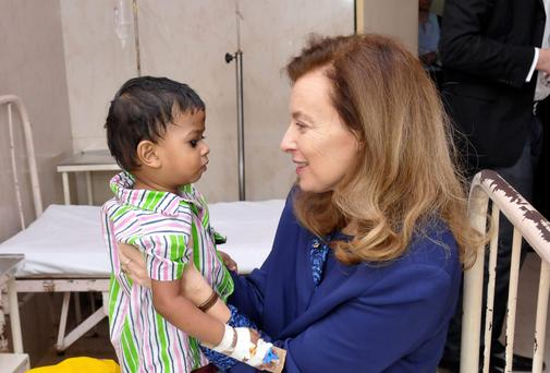 Valerie Trierweiler, right, the ex-first lady of French President Francois Hollande, holds a boy during a charity visit for NGO Action against Hunger in Mumbai, India