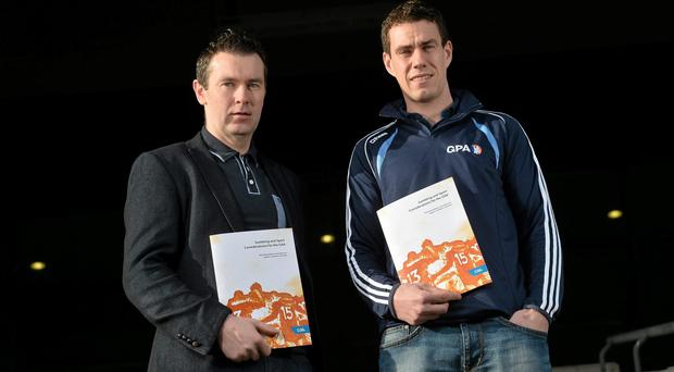 Former Armagh footballer Oisin McConville, left, and Offaly footballer Niall McNamee at the launch of the GAA/GPA Gambling Guidelines