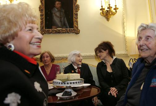 Helena Bonham Carter speaks with guests during a reception at 10 Downing Street for survivors of the Holocaust and other genocides