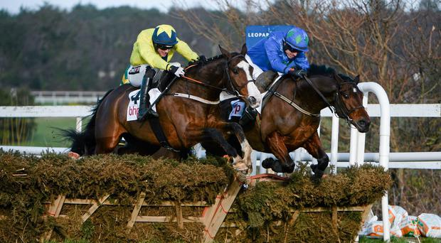 Hurricane Fly, right, with Ruby Walsh up, jumps the last together with Our Conor, left, with Danny Mullins up