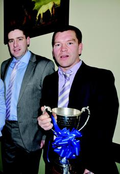 Shane Hourigan holding the cup and former Kerry footballer Darragh O'Shea. Photo: Gerry Molyneaux