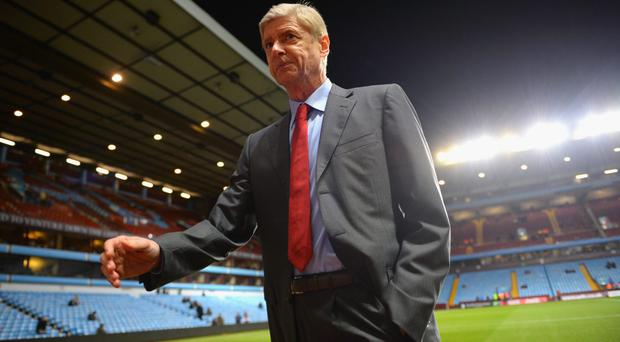 Manager Arsene Wenger of Arsenal walks pitchside ahead of the Barclays Premier League match between Aston Villa and Arsenal at Villa Park