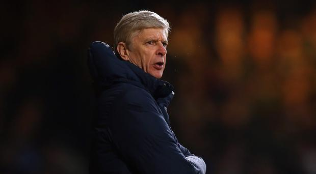 Arsene Wenger manager of Arsenal looks on during the Barclays Premier League match between West Ham United