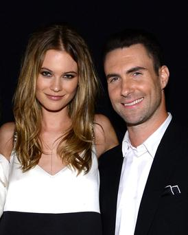 LOS ANGELES, CA - JANUARY 27: (L-R) Mdel Behati Prinsloo and recording artist Adam Levine of Maroon 5 attend