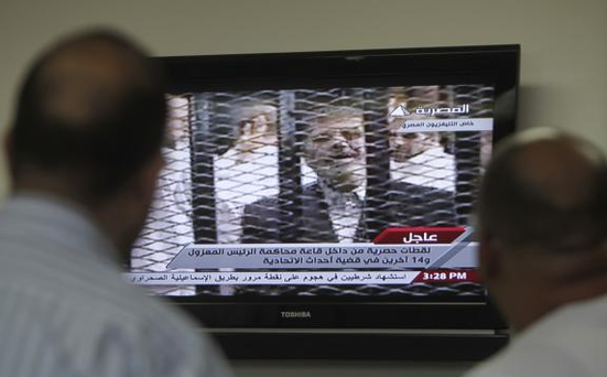 Deposed Egyptian President Mohamed Mursi of the Muslim Brotherhood went on trial at a Cairo police academy. Photo: Reuters/Mohamed Abd El Ghany