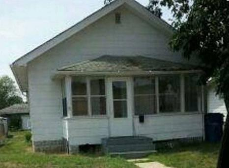 This image via the Hammond Police Department appears to show a figure at the window on the right side of the porch