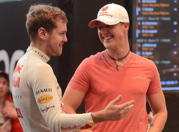 Sebastian Vettel and Michael Schumacher share a joke during the 2012 Race of Champions in Bangkok