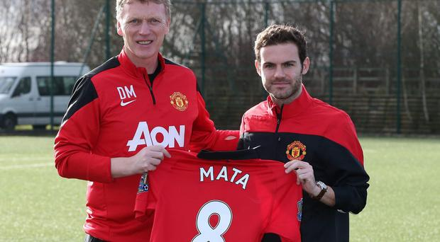 Manchester United's manager manager David Moyes and Juan Mata (right) following the Spaniard's unveiling at Carrington