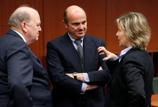Irish Finance Minister Michael Noonan talks to Spain's EconomyMinister Luis de Guindos (C) and Portugal's Finance Minister Maria Luis Albuquerque at a eurozone meeting on Monday