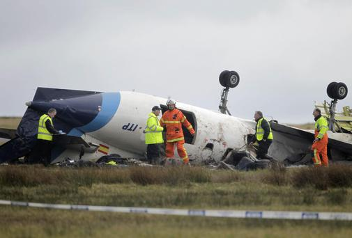 Six people died and six others were injured when the Manx2 plane crashed in fog at Cork Airport. PA