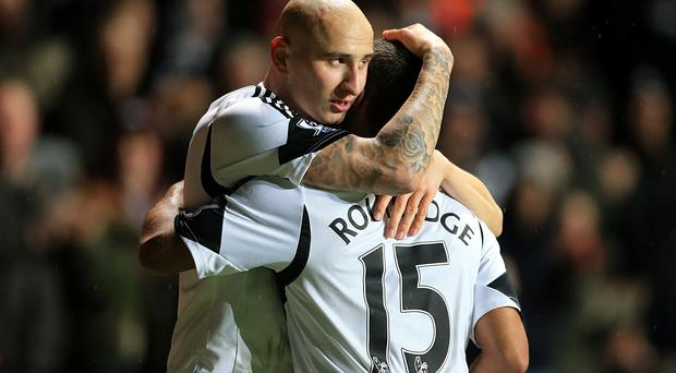 Swansea City's Jonjo Shelvey (left) celebrates scoring his side's first goal of the game with teammate Wayne Routledge during the Barclays Premier League match at the Liberty Stadium, Swansea