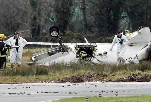 The scene at Cork Airport where six people died and six others were injured after the plane crashed in fog on February 10, 2011