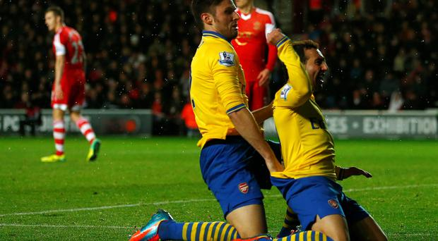 Arsenal's Santi Cazorla (R) celebrates his goal with teammate Olivier Giroud after scoring against Southampton during their English Premier League soccer match at St.Mary's Stadium in Southampton