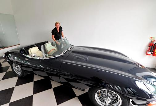 Michael Flatley with his vintage Jaguar - the dancer used another of his sports cars to chase the gang who raided his home.
