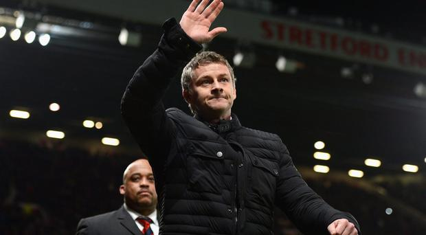 Cardiff City Manager Ole Gunnar Solskjaer salutes the crowd at Old Trafford