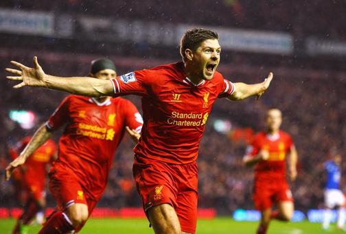 Steven Gerrard of Liverpool celebrates after scoring the opening goal against Everton on Tuesday