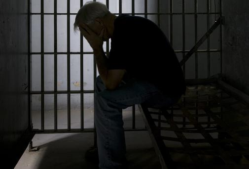 A violent man without money is much more likely to end up in prison. iStockphoto
