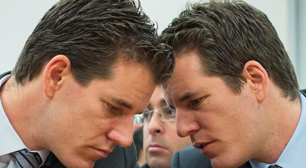 Brothers Cameron (L) and Tyler Winklevoss