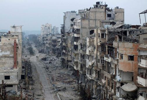 Damaged buildings line a street in the besieged area of Homs. Reuters