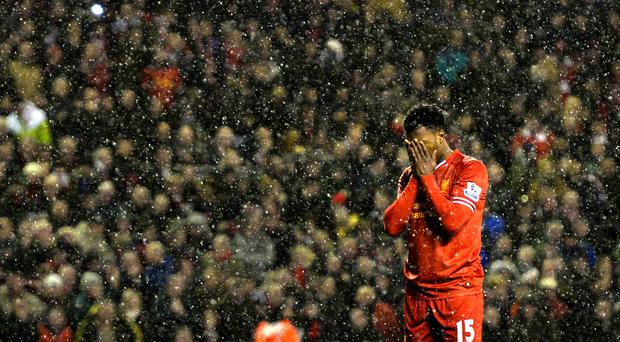 Liverpool's Daniel Sturridge reacts after missing a penalty during their Premier League match against Everton