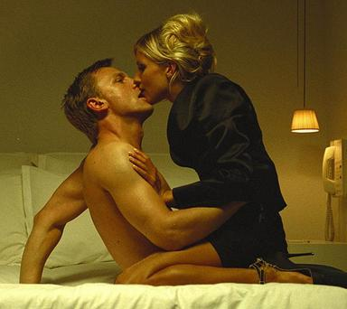Sienna Miller with Daniel Craig n the 2004 film Layer Cake.