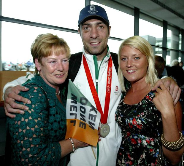 Olympic boxer Ken Egan, Silver, with his mother Maura and girlfriend Karen Sullivan in 2008