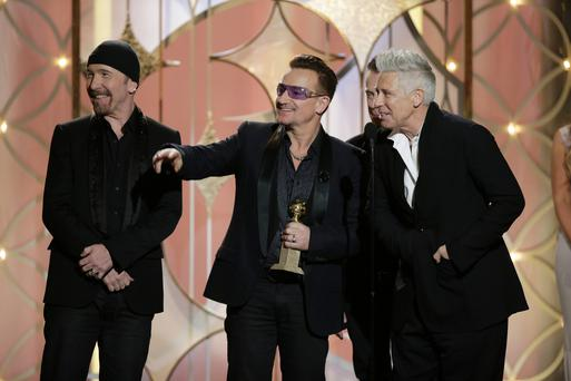 The Oscar-nominated band's new track 'Invisible' will be available worldwide as a free download for 24 hours on Sunday, February 2. (AP Photo/NBC, Paul Drinkwater)