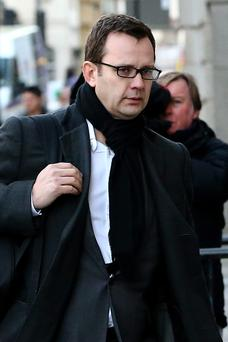 Former News of the World editor and Downing Street communications chief Andy Coulson arrives for the phone-hacking trial at the Old Bailey