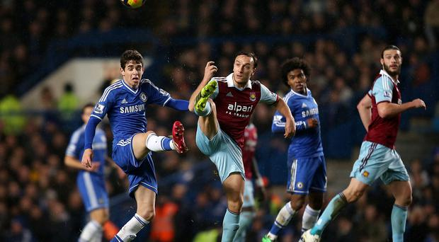Chelsea's Oscar and West Ham United's Mark Noble battle for the ball during the Barclays Premier League match at Stamford Bridge,