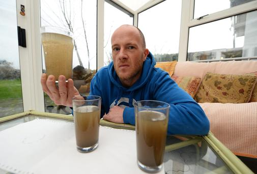 Lloyd Keane from Ballinorig West Tralee shows off the water from his water tap in his home