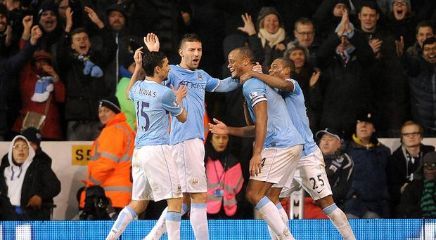 Manchester City's Vincent Kompany (second right) celebrates with team-mates after scoring his team's fifth goal during the Barclays Premier League match at White Hart Lane