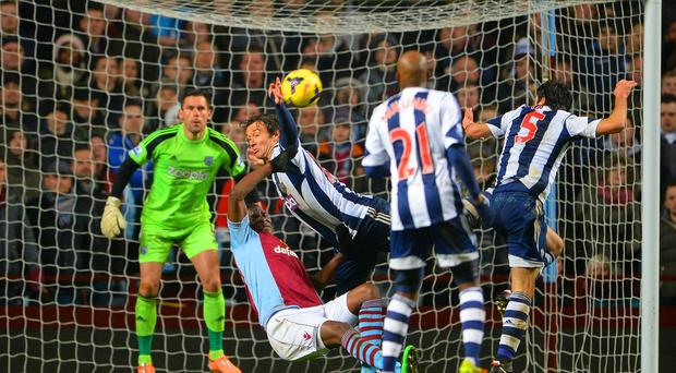 Foul by Diego Lugano of West Brom on Christian Benteke of Aston Villa