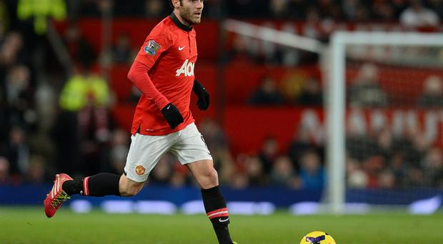 Manchester United's Spanish midfielder Juan Mata in action on his debut against Cardiff City