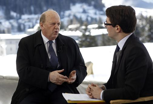 Finance minister Michael Noonan pictured talking to John Fraher, right, a managing editor at Bloomberg News during a Bloomberg Television interview of the World Economic Forum in Davos.