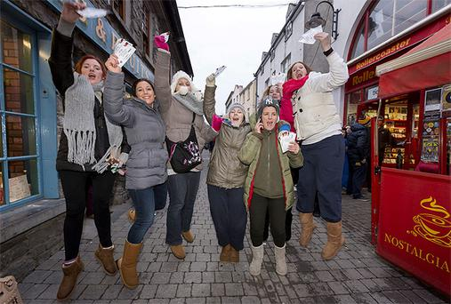 Fans Sharon Kelly, Danila Burke, Romina Perrozzi, Karen Tynan Kiely, Tracey Rowe, Emily Burke and Grace Breslin pictured with their Garth Brook tickets after queuing for days in Kilkenny