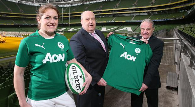 Ireland women's captain Fiona Coghlan with Director of AON Colum Diamond and IRFU President Pat Fitzgerald. Mandatory Credit ©INPHO/Billy Stickland