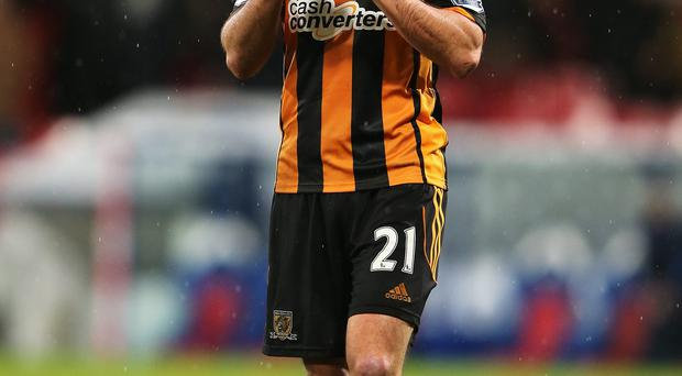 Shane Long of Hull City applauds the fans after the Barclays Premier League match against Crystal Palace